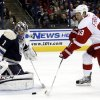 Photo - Detroit Red Wings' Johan Franzen, right, of Sweden, shoots the puck against Columbus Blue Jackets goalie Steve Mason in the first period of an NHL hockey game in Columbus, Ohio, Saturday, Feb. 2, 2013. Franzen scored on the play. (AP Photo/Paul Vernon)