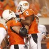 Photo - CELEBRATE / CELEBRATION: Noah Franklin (77) gives Beau Johnson (2) a lift after his touchdown at the college football game between Oklahoma State University (OSU) and Rice University at Boone Pickens Stadium in Stillwater, Okla., Saturday, Sept. 19, 2009. Photo by Doug Hoke, The Oklahoman. ORG XMIT: KOD
