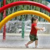 20-month-old Melonie Hernandez plays at Lippert Park Spray Ground at SW 54th and Shartel in Oklahoma City, Okla. July 02 , 2008. BY STEVE GOOCH, THE OKLAHOMAN.