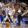 Oklahoma City Thunder\'s Russell Westbrook (0) and Utah Jazz\'s Al Jefferson (25) chase down a loose ball during the NBA basketball game between the Oklahoma City Thunder and the Utah Jazz at Chesapeake Energy Arena on Wednesday, March 13, 2013, in Oklahoma City, Okla. Photo by Chris Landsberger, The Oklahoman