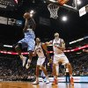 Denver Nuggets\' Kenneth Faried (35) shoots as Phoenix Suns\' Luis Scola (14), of Argentina, and Marcin Gortat, of Poland, defend and Suns\' Michael Beasley (0) and Nuggets\' Kosta Koufos (41) watch during the first half of an NBA basketball game, Monday, Nov. 12, 2012, in Phoenix. (AP Photo/Ross D. Franklin)