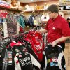 RETAIL GIFT SALES / I-35: Shaun Andrews, general manager of the Pauls Valley store, adds additional racing jackets to a clothes rack. The recently opened Love\'s Travel Plaza on Interstate 35 in Pauls Valley offers motorists and customers an expanded selection of items for sale inside the store. This travel center center stocks many items that usually aren\'t found in travel stores along the highways. Photo taken Tuesday, Dec. 20, 2011. Photo by Jim Beckel, The Oklahoman