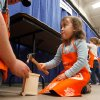 James Lewis with Home Depot holds a nail for 3-year-old Morgan Rieves while she builds a castle during the Cleveland County Fair Board\'s annual Home and Garden Super Show at the fairgrounds in Norman, Oklahoma on Saturday, February 9, 2008. BY STEVE SISNEY, THE OKLAHOMAN