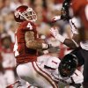 Oklahoma\'s Kenny Stills (4) tries to get away from Terrance Bullitt (1) during the college football game between the University of Oklahoma Sooners (OU) and the Texas Tech University Red Raiders (TTU) at Gaylord Family-Oklahoma Memorial Stadium in Norman, Okla., Saturday, Oct. 22, 2011. Photo by Bryan Terry, The Oklahoman