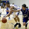 Harrah\'s Zack Manek and Guthrie\'s Codee Gross fight for a loose ball during the high school basketball game between Guthrie and Harrah at Guthrie, Okla.., Tuesday, Dec. 20, 2011. Photo by Sarah Phipps, The Oklahoman