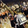 Booker T. Washington\'s Kaylan Mayberry (12) points to the Hornet fans as she holds the gold ball after the Class 6A girls championship high school basketball game in the state tournament at the Mabee Center in Tulsa, Okla., Saturday, March 9, 2013. Booker T. Washington beat Bixby, 52-46. Photo by Nate Billings, The Oklahoman