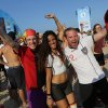 Soccer fans pose for a photo with a woman whose body is painted with Germany\'s national soccer team colors, at the end of a live broadcast of the World Cup match between Portugal and Germany, inside the FIFA Fan Fest area on Copacabana beach, in Rio de Janeiro, Brazil, Monday, June 16, 2014. Germany won 4-0. (AP Photo/Leo Correa)