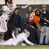 OSU\'s Tracy Moore (87) is tripped up by OU\'s Tony Jefferson (1) in front of Joseph Ibiloye (5) in the first quarter during the Bedlam college football game between the Oklahoma State University Cowboys (OSU) and the University of Oklahoma Sooners (OU) at Boone Pickens Stadium in Stillwater, Okla., Saturday, Dec. 3, 2011. Photo by Nate Billings, The Oklahoman