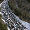 Photo - FILE - In this Wednesday, Jan. 29, 2014, file aerial photo, traffic is snarled along the Interstate 285 perimeter, north of the metro area after a winter snowstorm, in Atlanta. With memories of thousands of vehicles gridlocked for hours on icy metro Atlanta highways fresh in their minds, emergency officials and elected leaders in north Georgia were preparing Monday, Feb. 10, 2014, for another round of winter weather. (AP Photo/David Tulis, File)