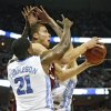 Oklahoma\'s Blake Griffin (23) drives past the defense of North Carolina\'s Deon Thompson (21) during the first half in the Elite Eight game of NCAA Men\'s Basketball Regional between the University of North Carolina and the University of Oklahoma at the FedEx Forum on Sunday, March 29, 2009, in Memphis, Tenn. PHOTO BY CHRIS LANDSBERGER, THE OKLAHOMAN