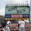 Photo - St. Louis Cardinals' Matt Carpenter, left, is congratulated by third base coach Jose Oquendo as he rounds the bases after hitting a solo home run during the first inning of a baseball game against the New York Mets Wednesday, June 18, 2014, in St. Louis. (AP Photo/Jeff Roberson)