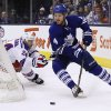 Toronto Maple Leafs\' Cody Franson skates past New York Rangers\' Ryan Callahan during the first period of an NHL hockey game in Toronto, Saturday, Jan. 4, 2014. (AP Photo/The Canadian Press, Mark Blinch)