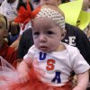 Five month old Payton Robertson waits for the soldiers to come home during the return ceremony for the National Guard\'s 45th Infantry Brigade Combat Team at the Army Aviation hanger at Will Rogers Air National Guard Base Sunday, March 25th, 2012. PHOTO BY HUGH SCOTT, FOR THE OKLAHOMAN