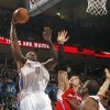 Oklahoma City Thunder center Kendrick Perkins (5) puts up a shot over Los Angeles Clippers power forward Blake Griffin (32) during the NBA basketball game between the Oklahoma City Thunder and the Los Angeles Clippers at Chesapeake Energy Arena on Wednesday, March 21, 2012 in Oklahoma City, Okla. Photo by Chris Landsberger, The Oklahoman