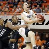Oklahoma State\'s Phil Forte (10) is folded by Portland State\'s Lamont Prosser (42) during the college basketball game between Oklahoma State University and Portland State, Sunday,Nov. 25, 2012. Photo by Sarah Phipps, The Oklahoman