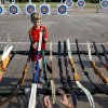 Matthew White, 12, of Norman picks up his bow during a Junior Olympic Archery Development Club shoot put on by the Trosper Archery Club on Saturday, August 24, 2013, at Trosper Park in Oklahoma City. White has been shooting for 3 years but was attending this shoot for the first time along with over 60 participants, from beginners to intermediates, that took part in the shoot which takes place every Saturday. For $5 each person is supplied with equipment and instruction starting at 9am for beginners and 10am for intermediate shooters. Photo by Bryan Terry, The Oklahoman