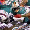 Buffalo Bills middle linebacker Kelvin Sheppard (55) tackles Miami Dolphins\' Reggie Bush (22) during the first half of an NFL football game on Thursday, Nov. 15, 2012, in Orchard Park, N.Y. (AP Photo/Bill Wippert)