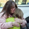 A mother hugs her daughter following a shooting at the Sandy Hook Elementary School in Newtown, Conn., about 60 miles (96 kilometers) northeast of New York City, Friday, Dec. 14, 2012. An official with knowledge of Friday\'s shooting said 27 people were dead, including 18 children. It was the worst school shooting in the country\'s history. (AP Photo/The New Haven Register, Melanie Stengel) ORG XMIT: CTNHR103
