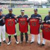 Photo - Milwaukee Brewers Manager Ron Roenicke, left, joins players Carlos Gomez (27) Jonathan Lucroy (20) Aramis Ramirez (16) and Francisco Rodriguez (57) who were presented their All-Star game jerseys before their baseball game against the St. Louis Cardinals Saturday, July 12, 2014, in Milwaukee. (AP Photo/Jeffrey Phelps)