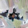 Photo - A Catholic prays behind papers, bearing New Year wishes, tied to trees at Myeongdong Catholic Cathedral in Seoul, South Korea, Monday, Dec. 31, 2102. The cathedral is Korea's oldest parish church and the symbol of Korean Catholics. (AP Photo/Ahn Young-joon)