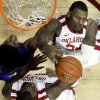 Oklahoma\'s Romero Osby, top, and Amath M\'Baye (22) fight Kansas\' Kevin Young (40) for a rebound of during the First half as the University of Oklahoma Sooners (OU) defeat the Kansas Jayhawks (KU) 72-66 in NCAA, men\'s college basketball at The Lloyd Noble Center on Saturday, Feb. 9, 2013 in Norman, Okla. Photo by Steve Sisney, The Oklahoman