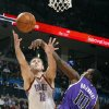 The Thunder\'s Nenad Krstic (12) lays up a shot past the Kings\' Samuel Dalembert (10) during the NBA basketball game between the Oklahoma City Thunder and The Sacramento Kings on Tuesday, Feb. 15, 2011, Oklahoma City Okla. Photo by Chris Landsberger, The Oklahoman