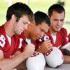 OU COLLEGE FOOTBALL: Quarterbacks Joey Halzle, Sam Bradford, and Landry Jones sign footballs during Fan Appreciation for the University of Oklahoma football team at the rugby fields in Norman, Oklahoma on Wednesday, August 6, 2008. BY STEVE SISNEY, THE OKLAHOMAN ORG XMIT: KOD