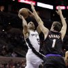 Photo - San Antonio Spurs' Tony Parker (9), of France, shoots over Phoenix Suns' Goran Dragic (1), of Slovenia, during the first half of an NBA basketball game, Wednesday, Feb. 27, 2013, in San Antonio. (AP Photo/Eric Gay)