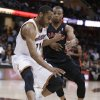 Cleveland Cavaliers\' Wayne Ellington, left, works against Toronto Raptors\' Sebastian Telfair during the fourth quarter of an NBA basketball game Wednesday, Feb. 27, 2013, in Cleveland. The Cavaliers won 103-92. (AP Photo/Tony Dejak)