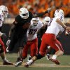 Oklahoma State\'s Ryan Robinson pressures Arizona\'s Nick Foles during their game on Thursday. PHOTO BY SARAH PHIPPS, The Oklahoman