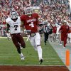 Oklahoma\'s Kenny Stills (4) scores a touchdown in front of Texas A&M\'s Terrence Frederick (7) during the college football game between the Texas A&M Aggies and the University of Oklahoma Sooners (OU) at Gaylord Family-Oklahoma Memorial Stadium on Saturday, Nov. 5, 2011, in Norman, Okla. Oklahoma won 41-25. Photo by Bryan Terry, The Oklahoman ORG XMIT: KOD