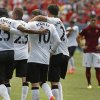 Photo - Manchester United players hug after a goal by Wayne Rooney during the first half of an exhibition soccer match against AS Roma at Mile High Stadium, in Denver, Saturday, July 26, 2014. (AP Photo/Brennan Linsley)