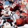 University of Oklahoma running back Mike Gaddis has the brakes put on by OSU defensive lineman Stacey Satterwhite during the Bedlam college football game on Nov. 16, 1991 in Norman, Okla. OU beat OSU, 21-6. Staff photo by Jim Beckel