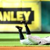 Photo - Houston Astros second baseman Jose Altuve (27) dives to get a glove on a single hit by Chicago White Sox's Alexei Ramirez (10) during the first inning of a baseball game, Saturday, June 15, 2013, in Houston. (AP Photo/Houston Chronicle, Karen Warren)