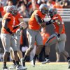 The Oklahoma State defense celebrates a play during a college football game between the Oklahoma State University Cowboys (OSU) and the Baylor University Bears (BU) at Boone Pickens Stadium in Stillwater, Okla., Saturday, Oct. 29, 2011. Photo by Sarah Phipps, The Oklahoman