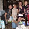 HE\'S A BOY....Karen Brown, Tierney Cash, Kirsten Cash and McKenna Cash open gifts at the baby shower for Kirsten Cash who is having a baby boy in January. She was the honoree at a baby shower. (Photo by Helen Ford Wallace).