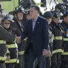 Republican presidential candidate Mitt Romney greets firefighters at Chicago O\'Hare International Airport, Tuesday, Sept. 11, 2012. (AP Photo/Charles Dharapak)