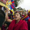 Exiled Tibetan Buddhist monks carrying Tibetan flags shout slogans during a protest march in Dharmsala, India, as they mark the anniversary of a failed 1959 uprising against Chinese rule, Sunday, March 10, 2013. Police in India prevented a Tibetan man from setting himself on fire as hundreds of Tibetan exiles gathered to mark the anniversary in Dharmsala, the home of Tibet\'s government in exile. (AP Photo/ Ashwini Bhatia)