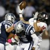 Yukon\'s Brandon Andraszek can\'t make the catch beside Edmond North\'s Jake Hobbs, left, and Dante Sanders during their high school football game at Wantland Stadium in Edmond, Okla., Thursday, October 4, 2012. Photo by Bryan Terry, The Oklahoman