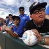 Photo - Raymond Rubavcava, 9, of Paris, Calif., waits for autographs before an exhibition baseball game between the Los Angeles Dodgers and the Chicago White Sox in Glendale, Ariz., Friday, Feb. 28, 2014. (AP Photo/Paul Sancya)