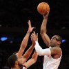New York Knicks\' Amare Stoudemire, right, shoots over Portland Trail Blazers\' LaMarcus Aldridge and Jared Jeffries, rear, during the first quarter of an NBA basketball game, Tuesday, Jan. 1, 2013, at Madison Square Garden in New York. (AP Photo/Bill Kostroun)
