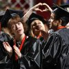 Laurel Grace Elliott Olkinetzky (left) looks toward the audience as family and supporters of graduating seniors are recognized during Norman High School graduation ceremony at the Lloyd Noble Center in Norman, Okla. on Saturday, May 23, 2009. Photo by Steve Sisney, The Oklahoman