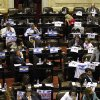 Lawmakers debate the YPF bill on the expropriation of the oil company in Buenos Aires, Argentina, Thursday, May 3, 2012. President Cristina Fernandez, who pushed forward a bill to renationalize the country\'s largest oil company, said the legislation put to congress would give Argentina a majority stake in oil and gas company YPF by taking control of 51 percent of its shares currently held by Spain\'s Repsol. (AP Photo/Natacha Pisarenko)