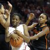 Oklahoma State\'s Tiffany Bias (3) and Toni Young (15) fight Sharane Campbell (24) for a rebound during the women\'s Bedlam basketball game between Oklahoma State University and Oklahoma at the Lloyd Noble Center in Norman, Okla., Sunday, Feb. 10, 2013.Photo by Sarah Phipps, The Oklahoman