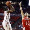 Oklahoma\'s Aaryn Ellenberg (3) shoots a basket in front of Leanne Ockenden (11) during the women\'s college basketball game between the University of Oklahoma and Marist at Lloyd Noble Center in Norman, Okla., Sunday,Dec. 2, 2012. Photo by Sarah Phipps, The Oklahoman