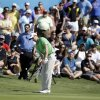 Photo - The gallery watches as Brendon Todd chips onto the 17th green during the final round of the Byron Nelson Championship golf tournament, Sunday, May 18, 2014, in Irving, Texas. Todd won the tournament. (AP Photo/Tony Gutierrez)