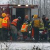 A helicopter and waiting ground crew transfer a worker injured working on the mudslide into a waiting ambulance from a Snohomish County helicopter, Tuesday, March 25, 2014, near Oso, Wash. A massive mudslide struck near Arlington, Wash., on Saturday, killing at least 14 people over the weekend and leaving scores more missing. (AP Photo/The Herald, Mark Mulligan)