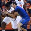 Photo - Oklahoma State guard Jean-Paul Olukemi, left, steals the ball from Tennessee Tech guard Jeremiah Samarrippas, right, during the first half of an NCAA college basketball game in Stillwater, Okla., Saturday, Dec. 22, 2012.  (AP Photo/Brody Schmidt)