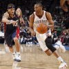 Oklahoma City\'s Russell Westbrook (0) drives to the basket as Cleveland\'s Delonte West (13) chases him during the NBA basketball game between the Oklahoma City Thunder and the Cleveland Cavaliers, Sunday, Dec. 13, 2009, at the Ford Center in Oklahoma City. Photo by Sarah Phipps, The Oklahoman ORG XMIT: KOD