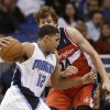Orlando Magic\'s Tobias Harris (12) drives around Washington Wizards\' Jan Vesely, of the Czech Republic, during the first half of an NBA basketball game, Friday, March 29, 2013, in Orlando, Fla. (AP Photo/John Raoux)